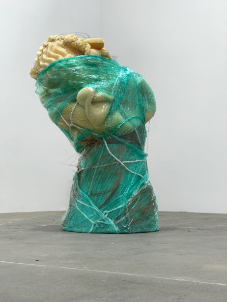 Untitled | used mattress pad, palm fibers, synthetic rope, poly cord, green plastic wrap, local dirt, and lamp shade frame