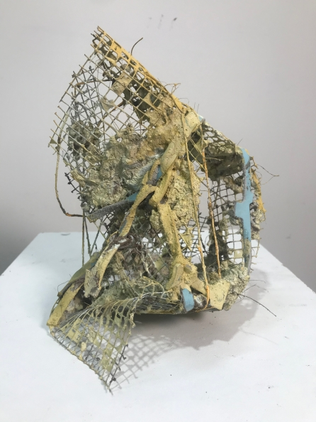 Lost and Found | 2020 | excavated urban earth, lime wash, screen mesh, leather scrap, twine, palm fibers
